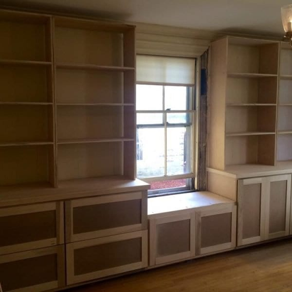 Wall to Wall Wood Built-In with Shelves and Custom Cabinets